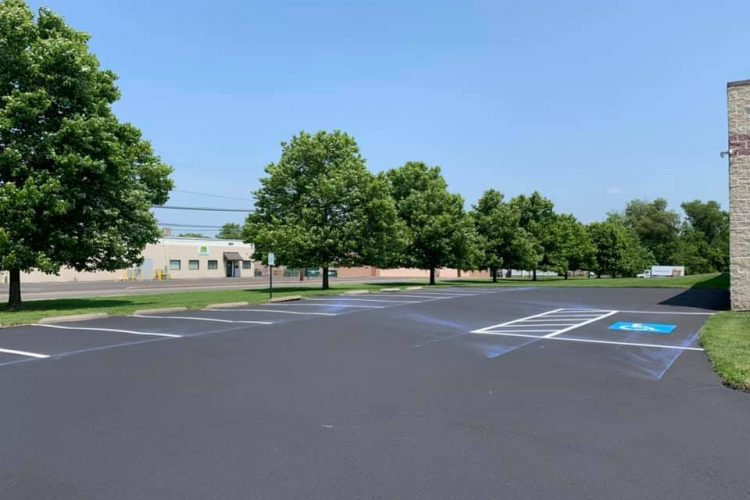 What Are the Pros and Cons of Commercial Asphalt Sealcoating?